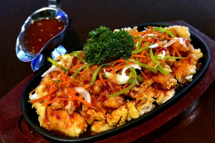 Crispy chicken with salad sauce is on the menu at T-Rex Karaoke, Grand Indonesia mall, Jakarta.