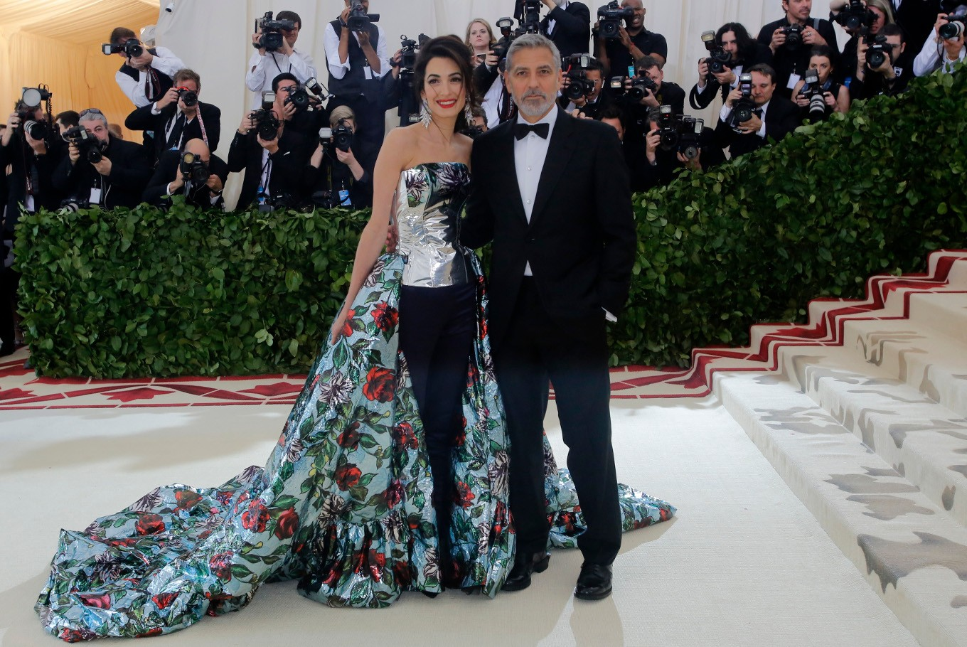 George and Amal Clooney arrive at the Metropolitan Museum of Art Costume Institute Gala (Met Gala) to celebrate the opening of 'Heavenly Bodies: Fashion and the Catholic Imagination' in the Manhattan borough of New York, U.S., May 7, 2018.