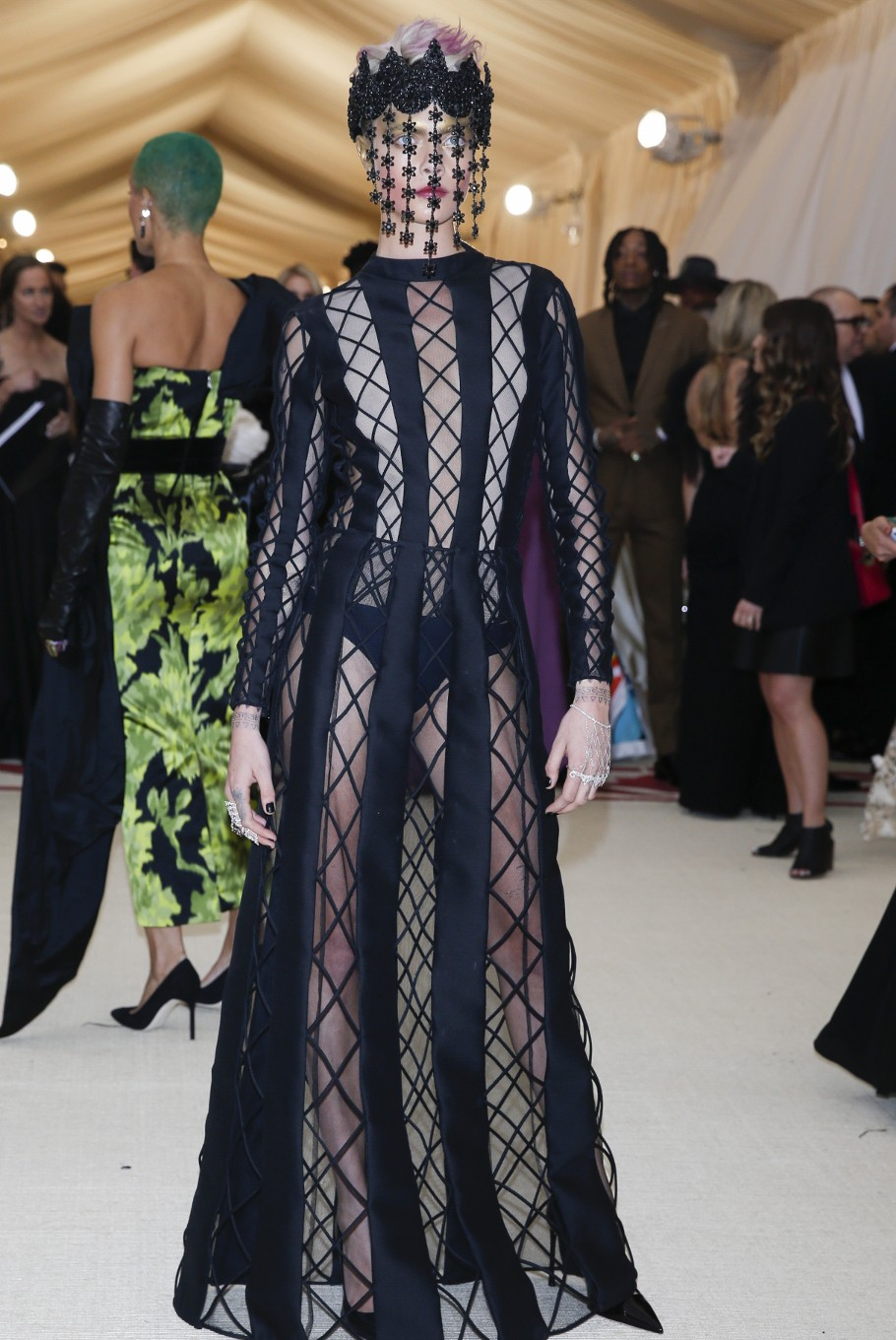 Model Cara Delevingne arrives at the Metropolitan Museum of Art Costume Institute Gala (Met Gala) to celebrate the opening of 'Heavenly Bodies: Fashion and the Catholic Imagination' in the Manhattan borough of New York, U.S., May 7, 2018.