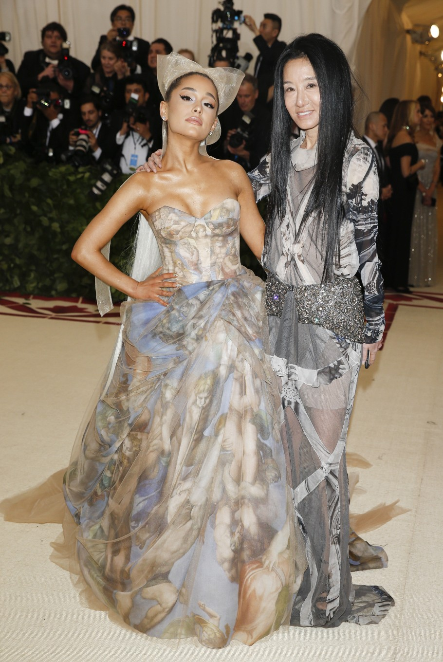 Singer Ariana Grande and designer Vera Wang arrive at the Metropolitan Museum of Art Costume Institute Gala (Met Gala) to celebrate the opening of 'Heavenly Bodies: Fashion and the Catholic Imagination' in the Manhattan borough of New York, U.S., May 7, 2018.