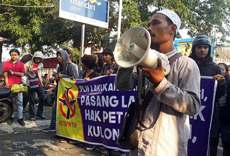 Local Islamic figure Ustadz Sofyan, one of the leaders of an association of local residents rejecting eviction in Kulon Progo, delivers a speech to call for state utility firm PLN Yogyakarta to reinstall electricity networks to their houses.