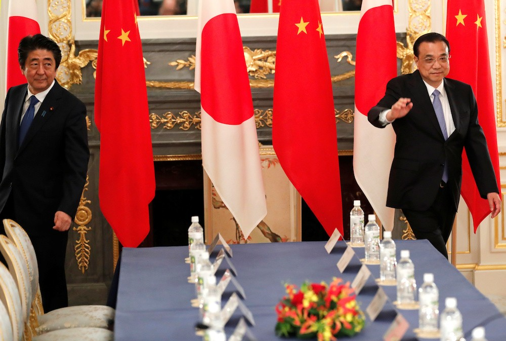 Abe may visit China on Oct. 23 to meet Xi