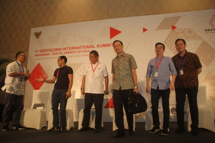 'Virtual ambassadors':  Communications and Information Minister Rudiantara (third left) and Investment Coordinating Board (BKPM) chairman Thomas Lembong (third right) pose for a photograph with (from left) Nexticorn ambassador Daniel Tamiwa, Go-Jek founder and CEO Nadiem Makari, Tokopedia founder and CEO William Tanuwijaya and Traveloka founder and CEO Ferry Unardi. The group of leading drivers of the digital economy appeared at a May 9 press conference for the 1st Nexticorn International Summit Indonesia in Nusa Dua, Bali.