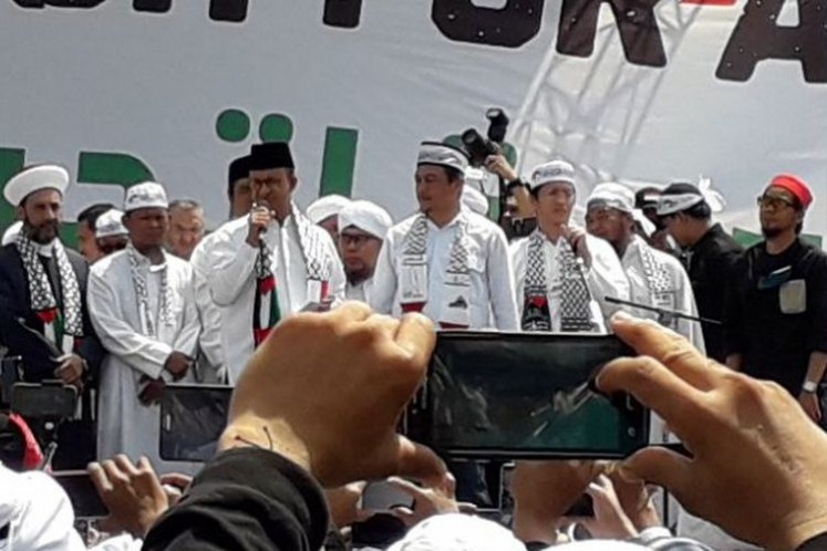 Jakarta Governor Anies Baswedan (third left) attends the Aksi Indonesia Bebaskan Baitul Maqdis (Indonesia for the Liberation of Jerusalem) rally on May 11 at National Monument (Monas) Square in Central Jakarta. The rally protested the United States' recognition of Jerusalem as the Israeli capital.