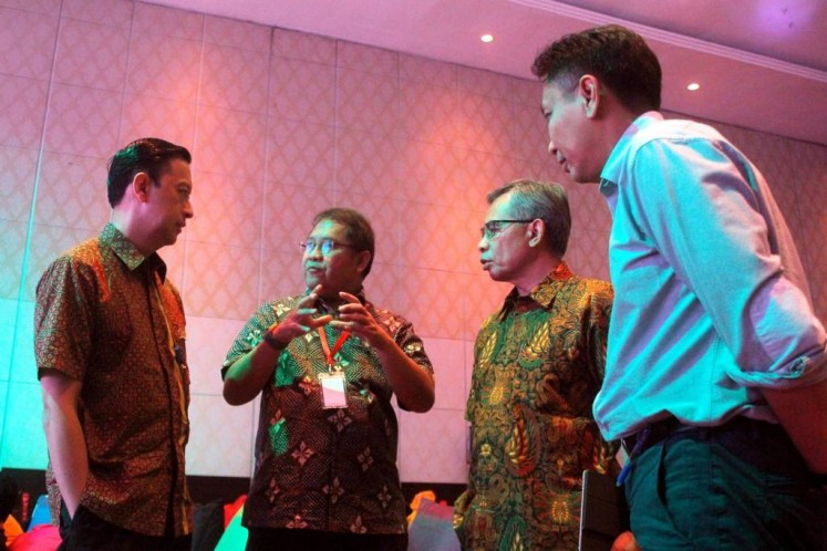 Big talk: Investment Coordinating Board (BPKM) chairman Thomas Lembong (left to right) in discussion with Communications and Information Minister Rudiantara, Financial Services Authority (OJK) chairman Wimboh Santoso and Bank Indonesia's head of Payment Systems Policy Onny Widanarko  at the first Next Indonesian Unicorn (NextICorn) Summit in Nusa Dua, Bali, on Thursday.