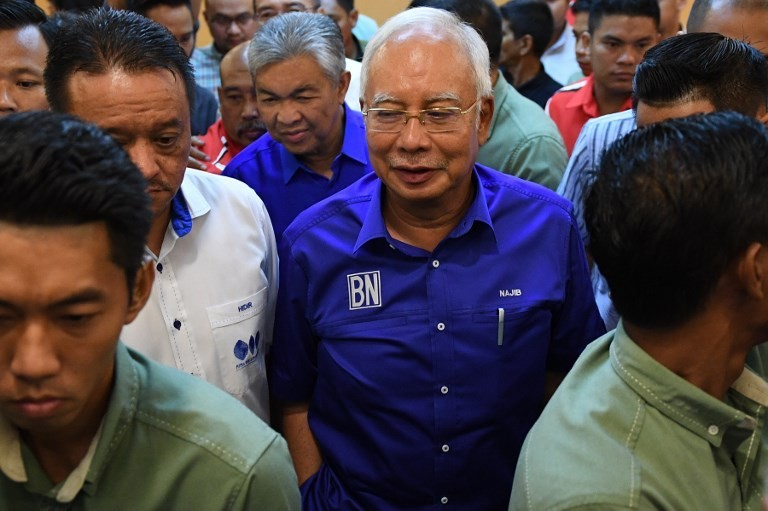 Malaysian police search five places linked to ousted PM Najib