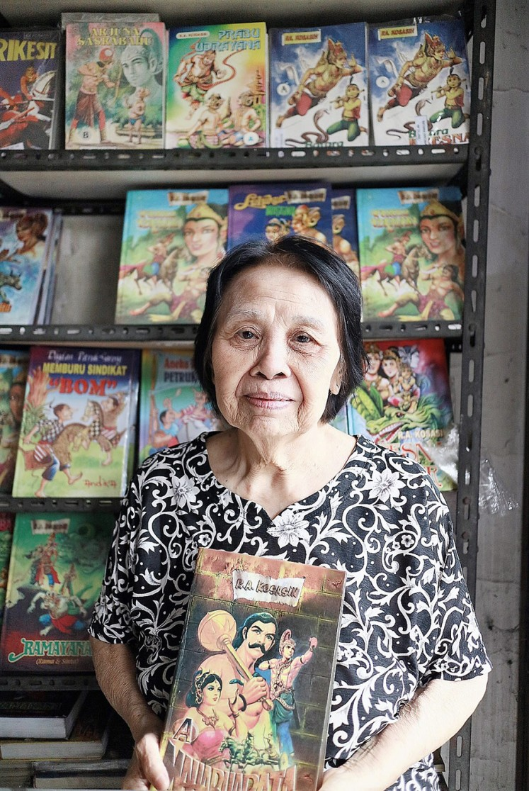 Sole guardian: Herlina Markus poses with a comic book in her Maranatha comic store in Bandung, West Java.