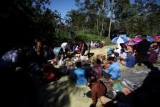 Sharing food tightens the bond among villagers. JP/Boy T. Harjanto