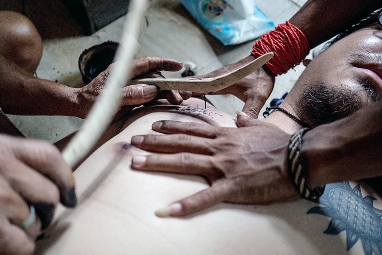 Tattoo: Mentawai tribesmen demonstrate the traditional art of tattoo.
