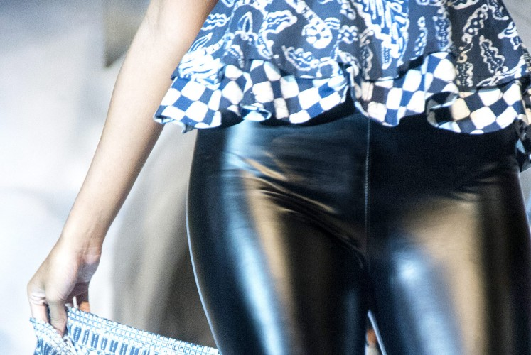 In contrast: A closer look at batik paired with latex pants.