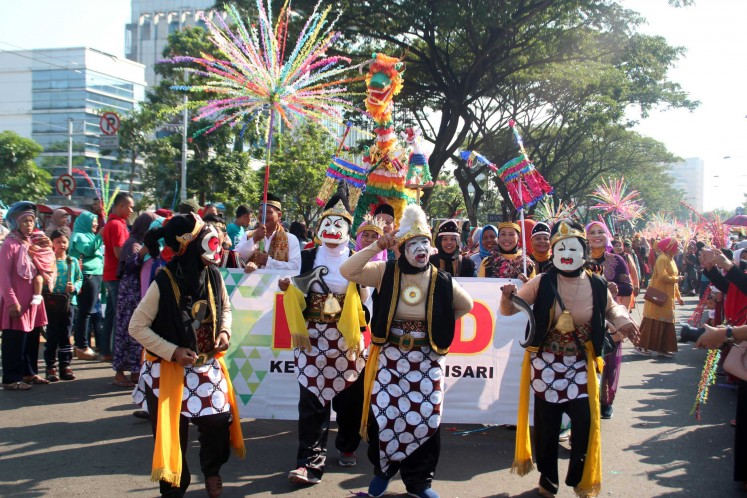 Semarang citizens wearing costumes participate in the Dugderan carnival held annually to celebrate the coming of Ramadhan.