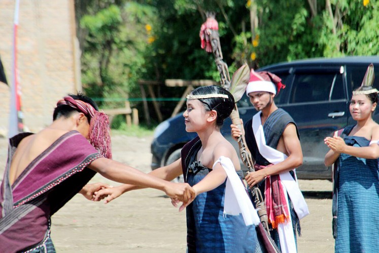Finding your mate: Young Bataknese couples dance during the Gondang Naposo Festival in Samosir, North Sumatra.