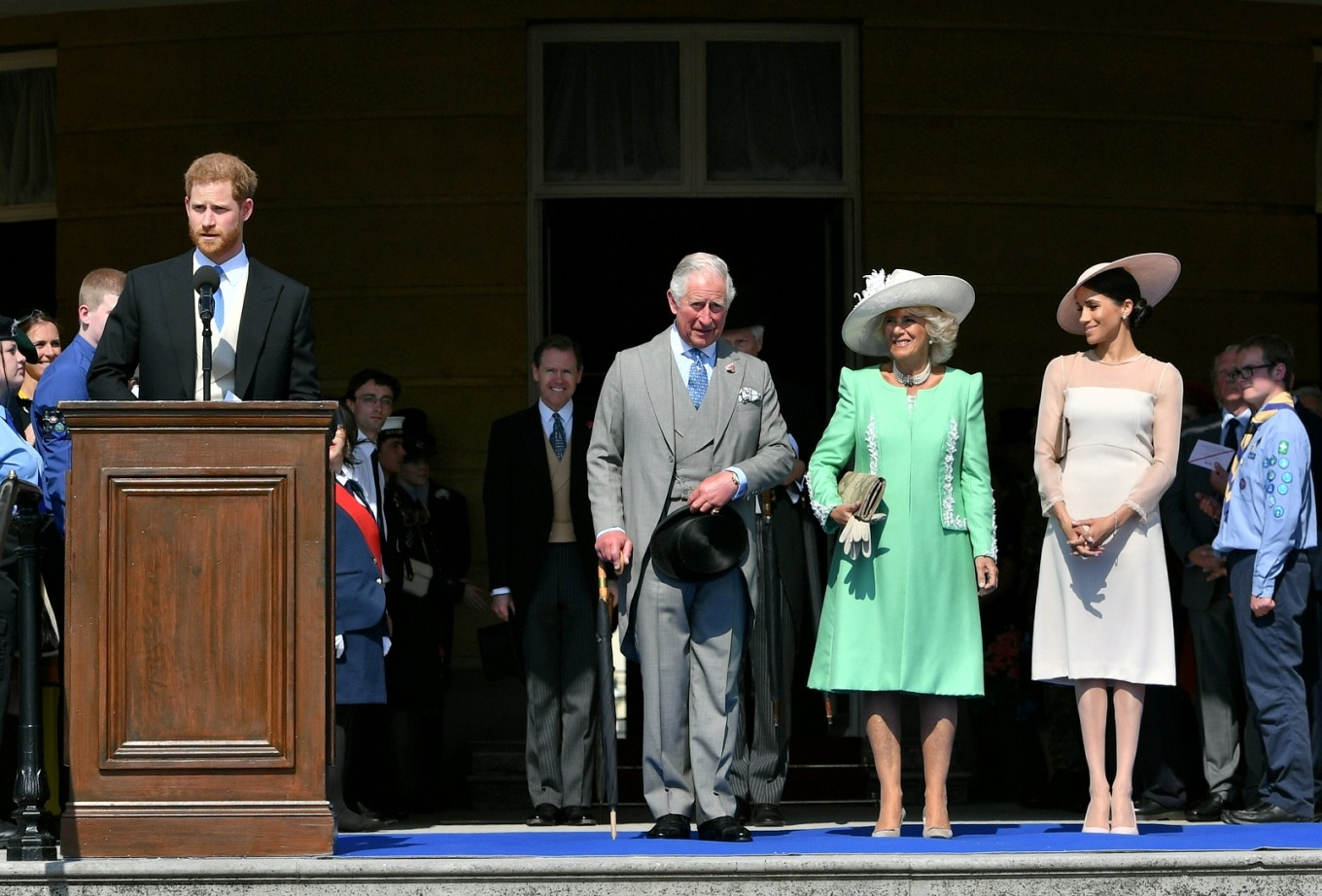 UK's Prince Harry and Meghan Markle attend Charles' garden party