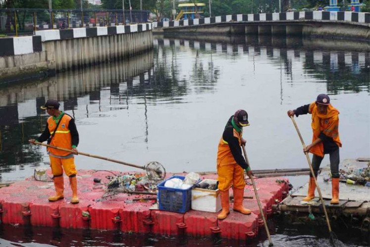 Public Facility Maintenance Agency personnel clean up the