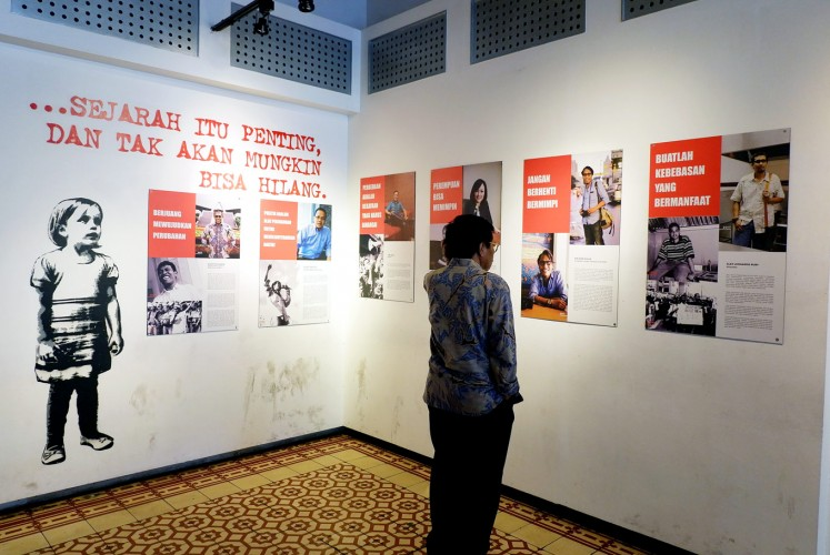 Now and then: A visitor looks at photos of 1998 activists at Antara Photojournalism Gallery in Jakarta.