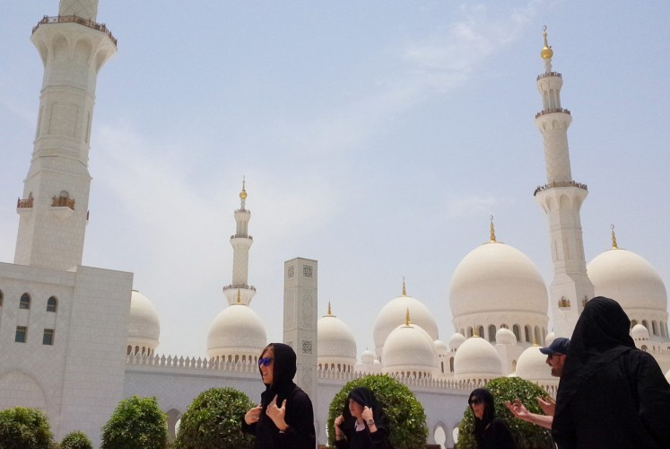 Transcendental: Visitors walk through the Sheikh Zayed Grand Mosque compound.