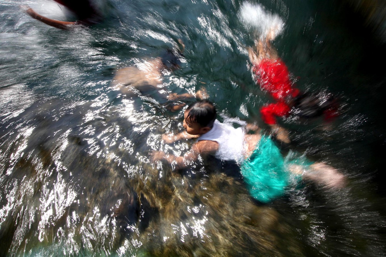 Three boys happily swim at the Umbul Pajangan pool. JP/Boy T. Harjanto