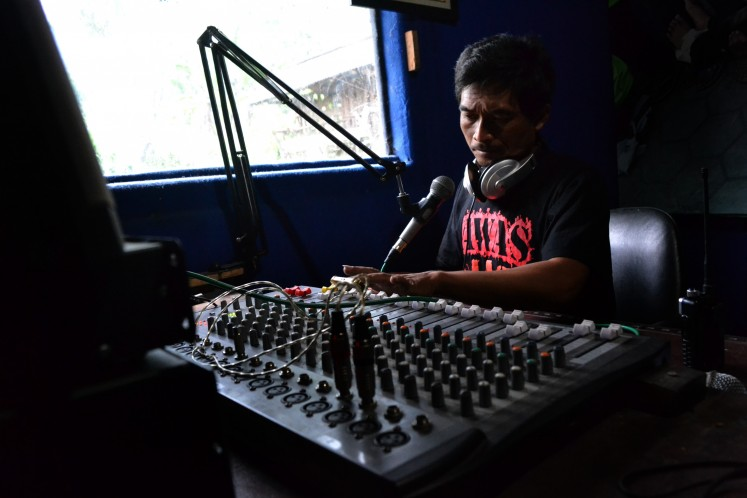 Broadcaster Diemas Retho, who also works as sand miner on Merapi.