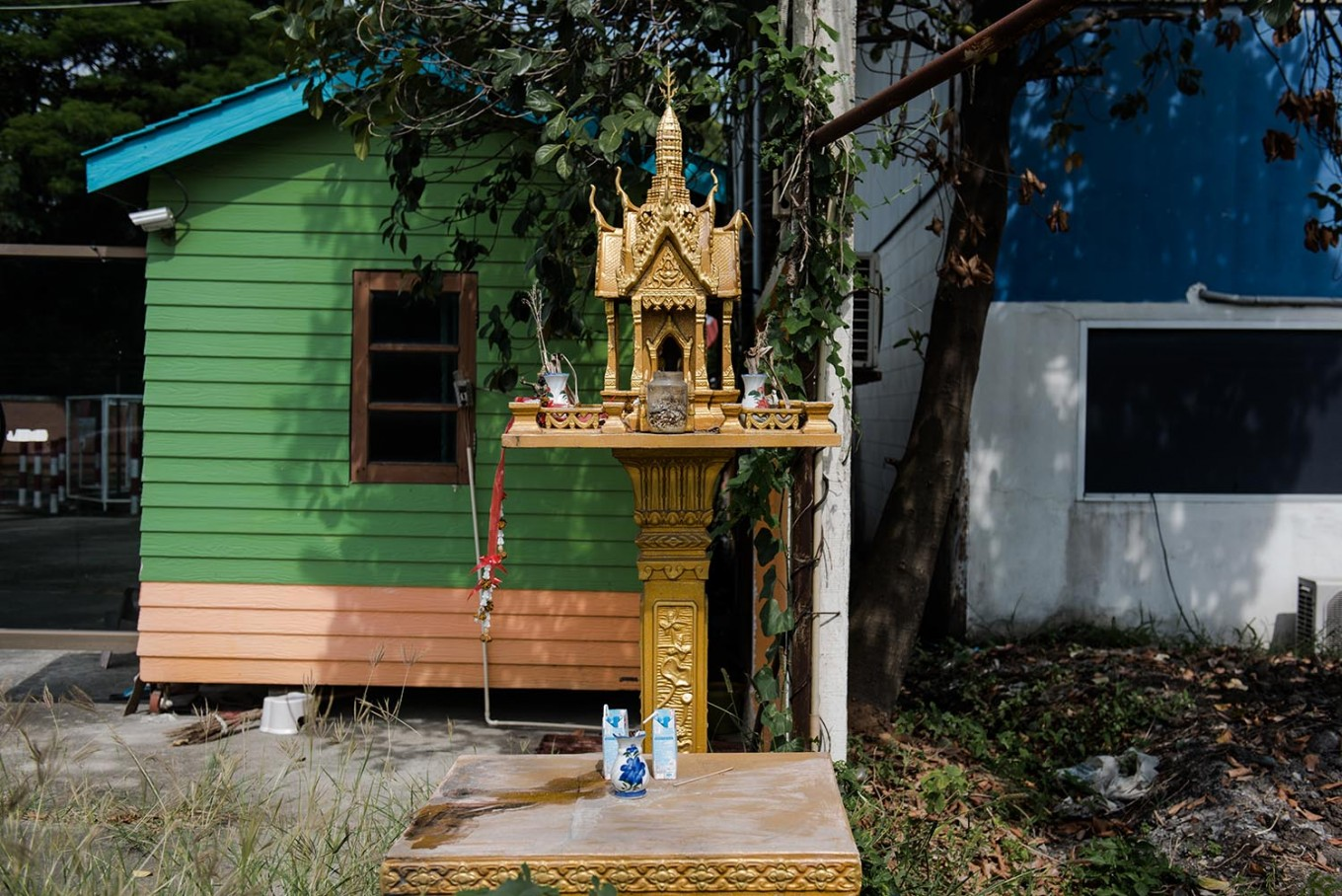 A spirit house is located on a sidewalk in Lopburi, Thailand. JP/Anggara Mahendra