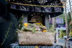 Offerings are placed in the stone alter in Denpasar, Bali. JP/Anggara Mahendra
