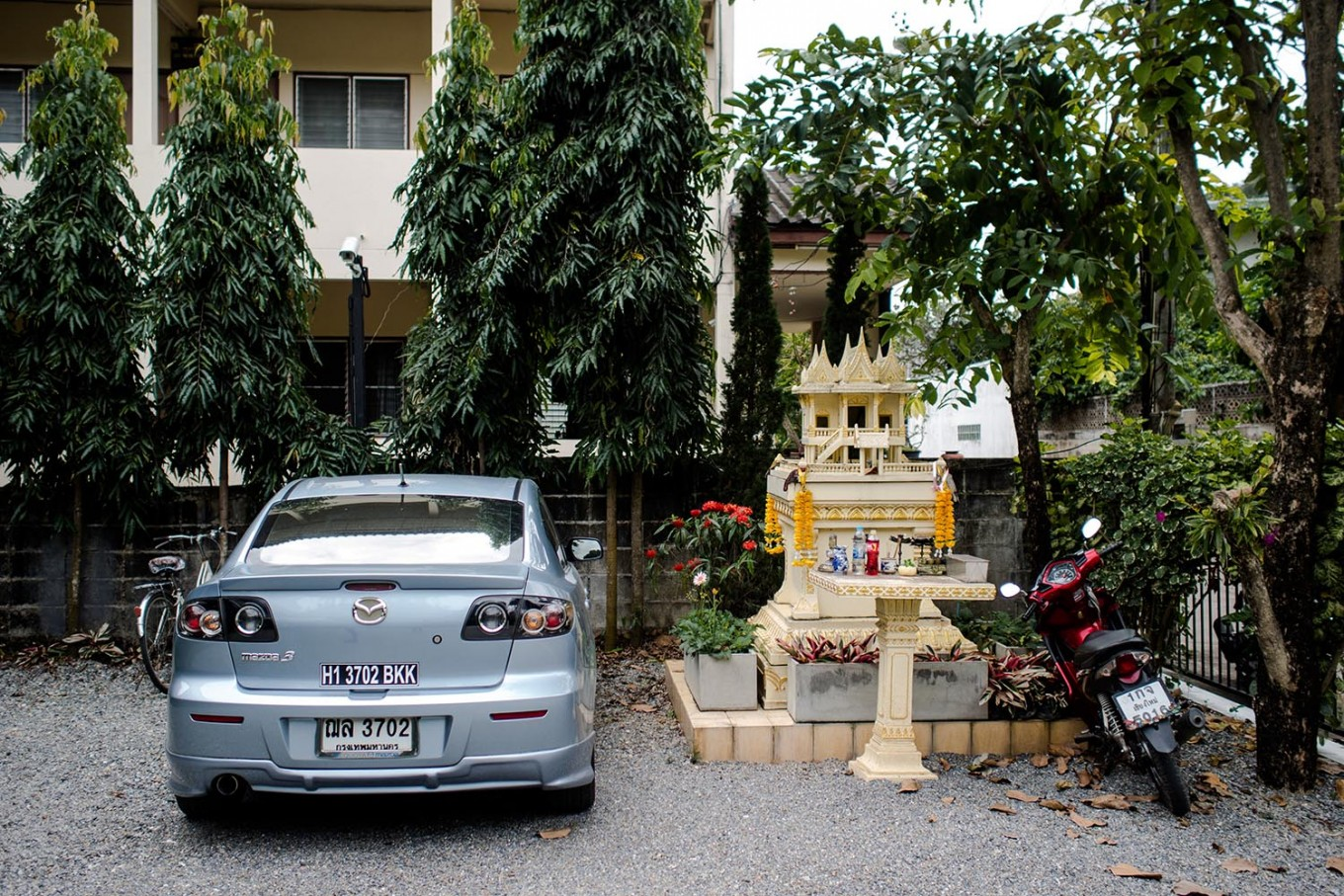 A spirit house is located at the parking lot of an inn in Chiang Mai, Thailand. JP/Anggara Mahendra