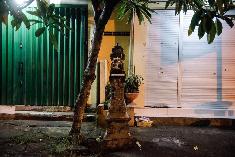 A wooden alter is placed in front of a store on Jl. Hayam Wuruk, Denpasar, Bali. JP/Anggara Mahendra
