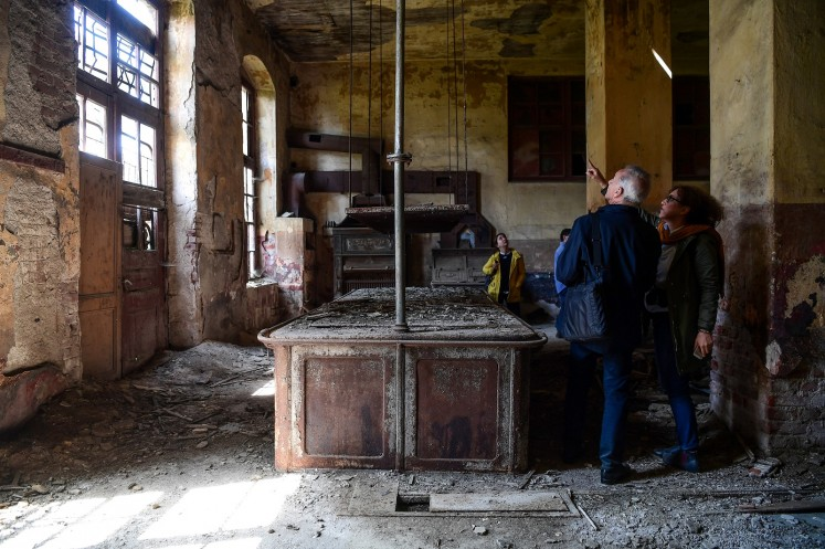 Architects visit the kitchen of the old Prinkipo Greek Orthodox orphanage at Princes island in Istanbul, on April 14, 2018.