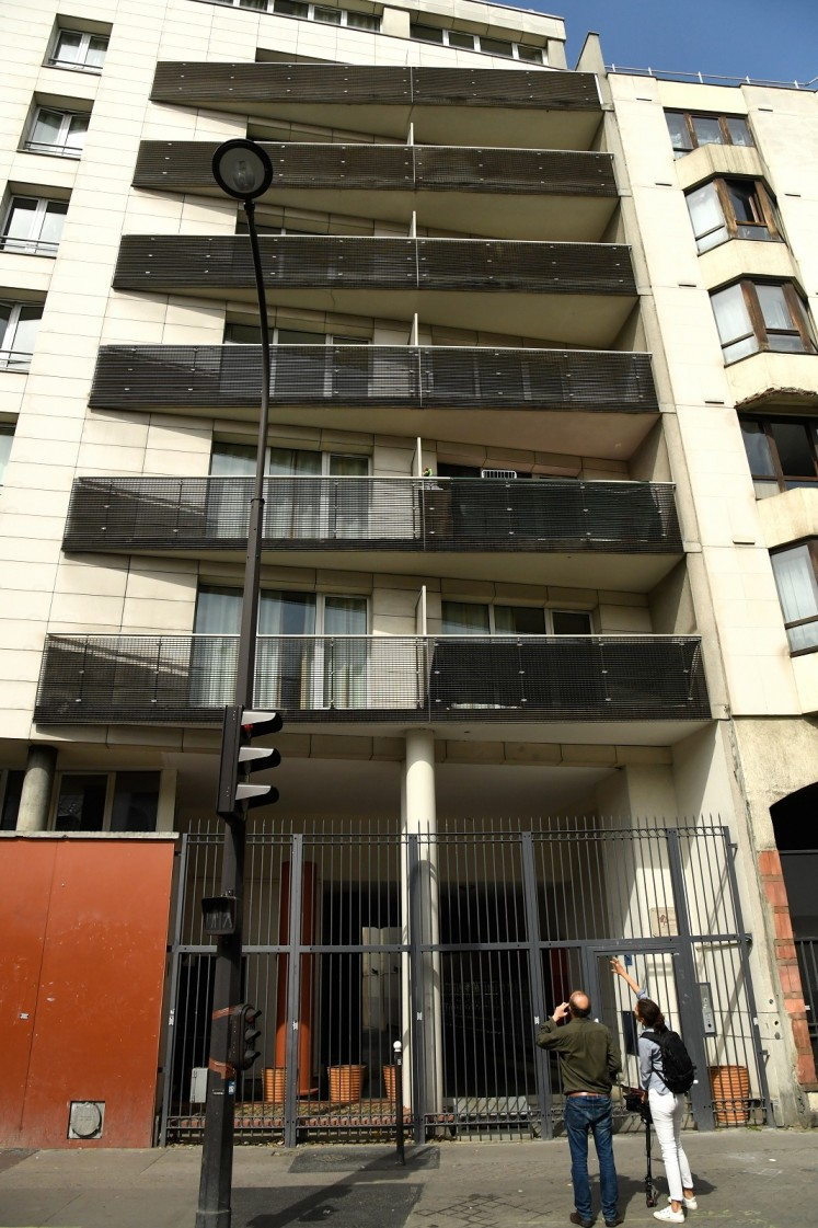 This picture taken on may 28, 2018 shows the facade of a building in Paris scaled by a 22-year old Mamoudou Gassama from Mali to save a 4-year-old child dangling from a fifth-floor balcony.