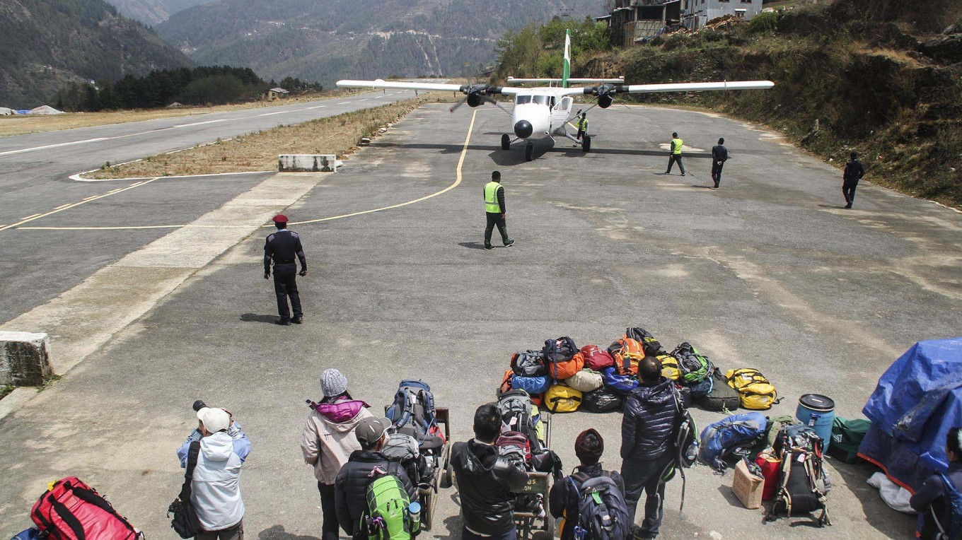 The journey begins: Travelers wait for their seven-minute flight from Phaplu Airport to Tenzing-Hillary Airport in Lukla. JP/ Adeline Sunarjo