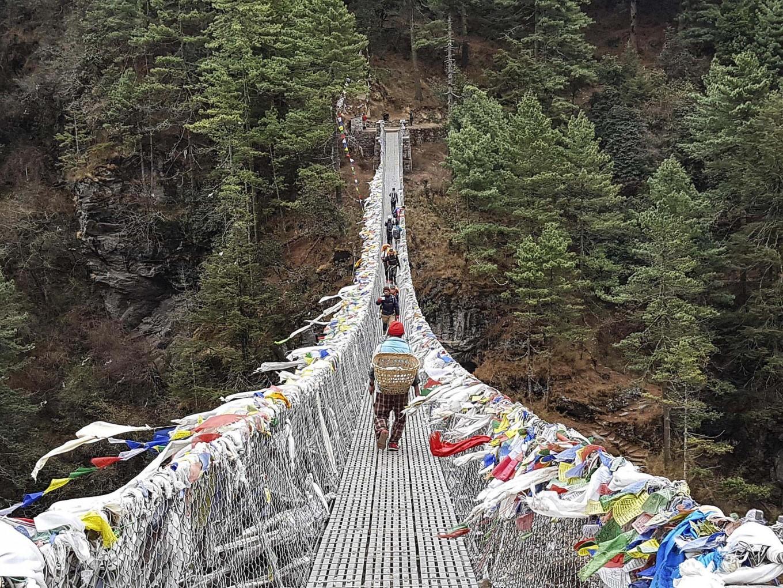 Don't look down: Trekkers must cross numerous high suspension bridges to cross deep valleys. JP/ Adeline Sunarjo