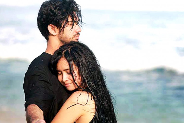 Blinded when I see you: Reza Rahadian's and Ayushita Nugraha's characters embrace on a beach in Yogyakarta as they play out their love story