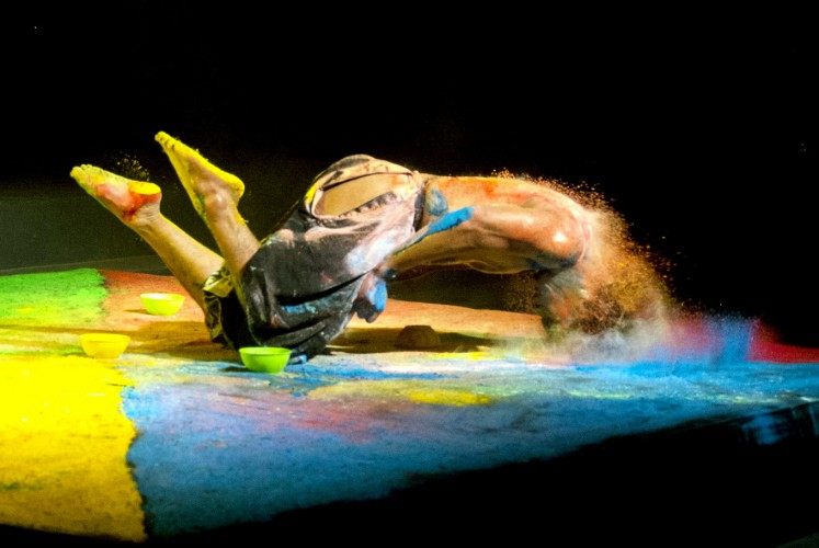Crashing: The dancer uses bright-colored powder as part of his performance.
