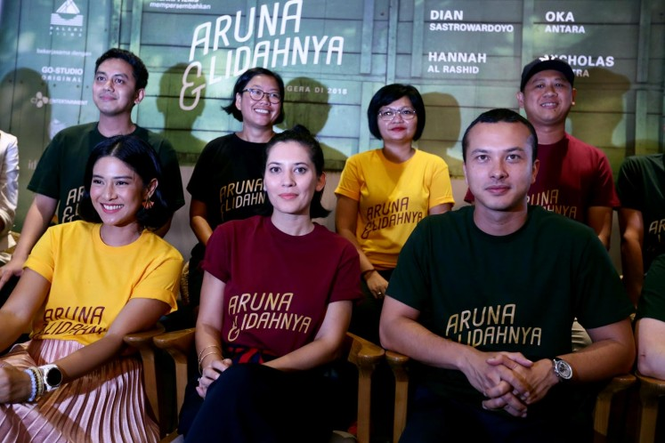 Crews and casts of 'Aruna and Her Palate'; (above, from left to right) producer Muhammad Zaidy, producer Meiske Taurisia, scriptwriter Titien Wattimena and director Edwin. (below, from left to right) Dian Sastrowardoyo, Hannah Al-Rashid and Nicholas Saputra.