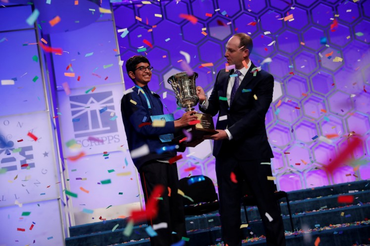 Karthik Nemmani celebrates with E.W. Scripps Company CEO Adam Symson after winning the Scripps National Spelling Bee at National Harbor in Oxon Hill, Maryland, U.S., May 31, 2018.