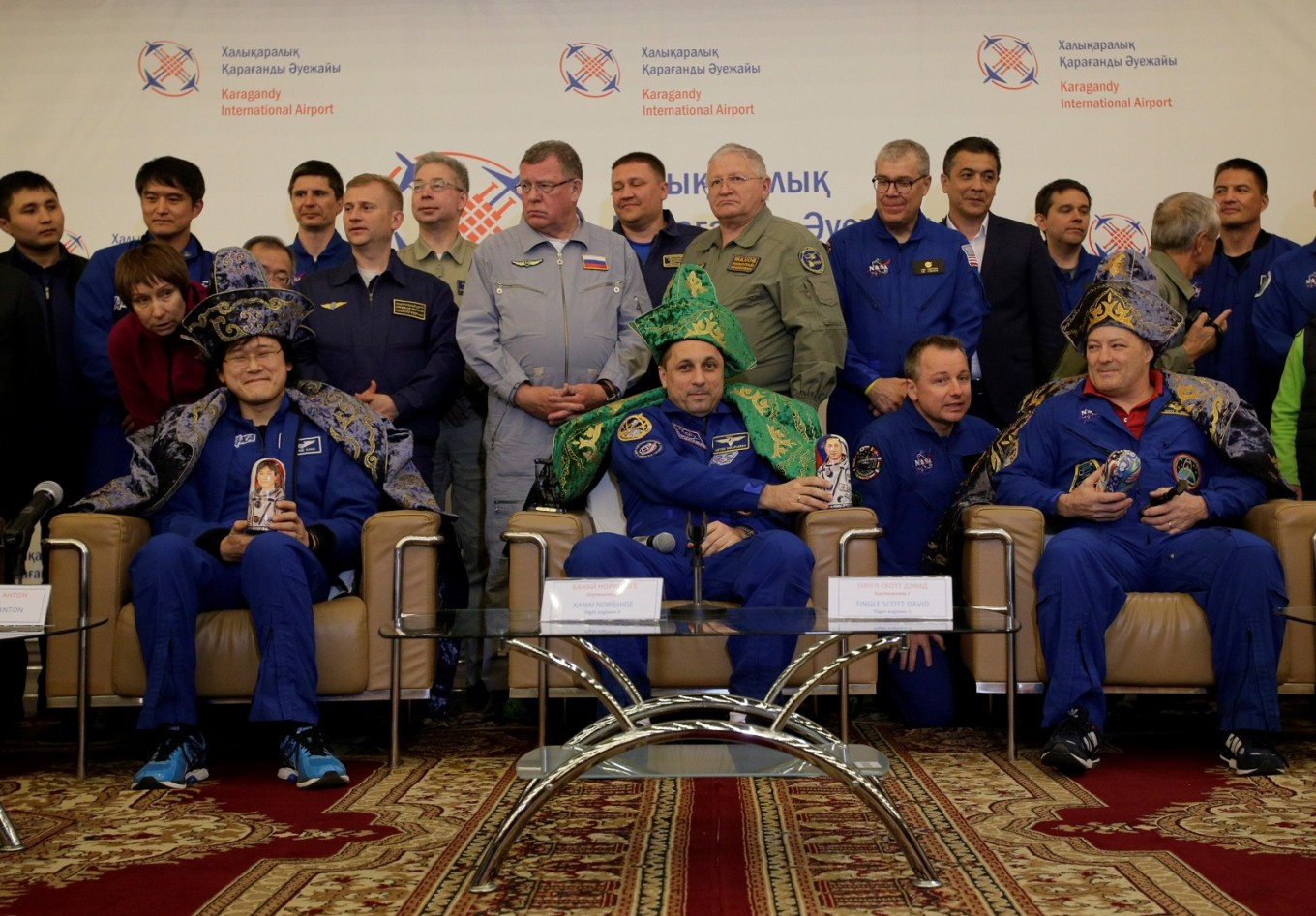Trio reach Earth from ISS with football slated for World Cup