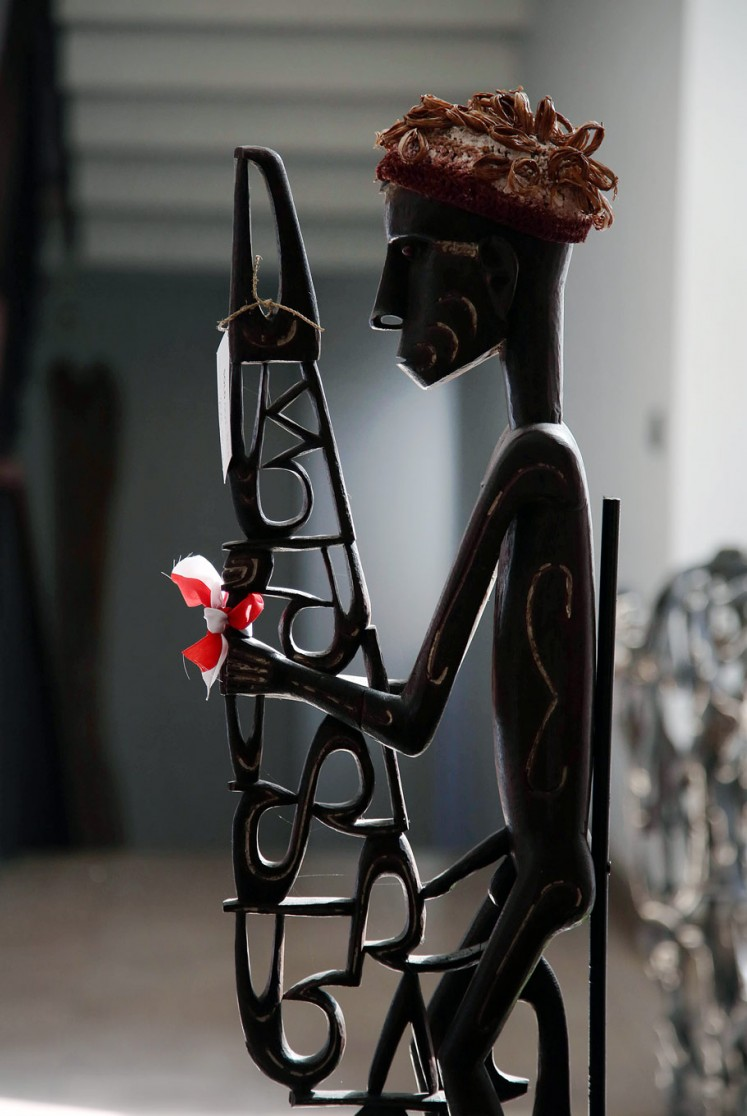 For the departed: An Asmat sculpture called Bisj (Mbis) which represents the ancestors.