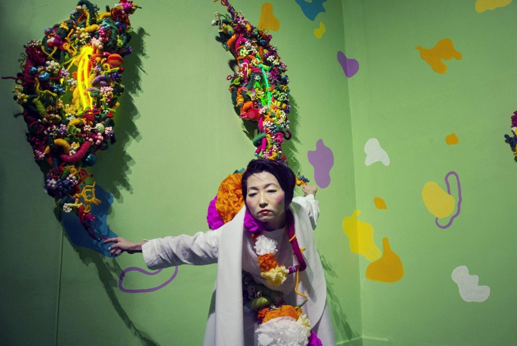 Say it with flowers: Artist Hiromi Tango performs next to her art installation Healing Garden during ARTJOG 2018 at the Jogja National Museum in Yogyakarta.