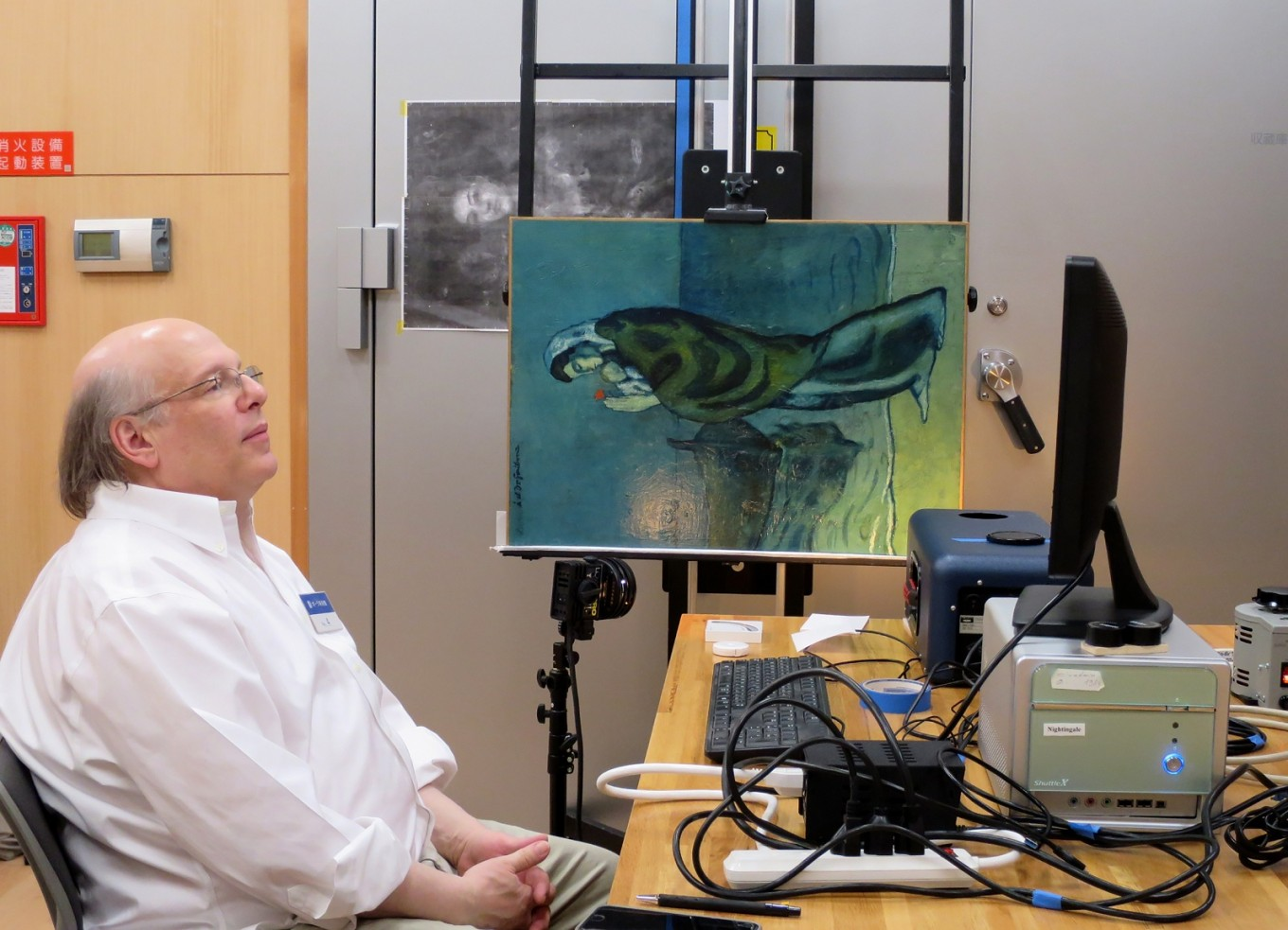 Scans reveal newsprint, second painting under Picasso