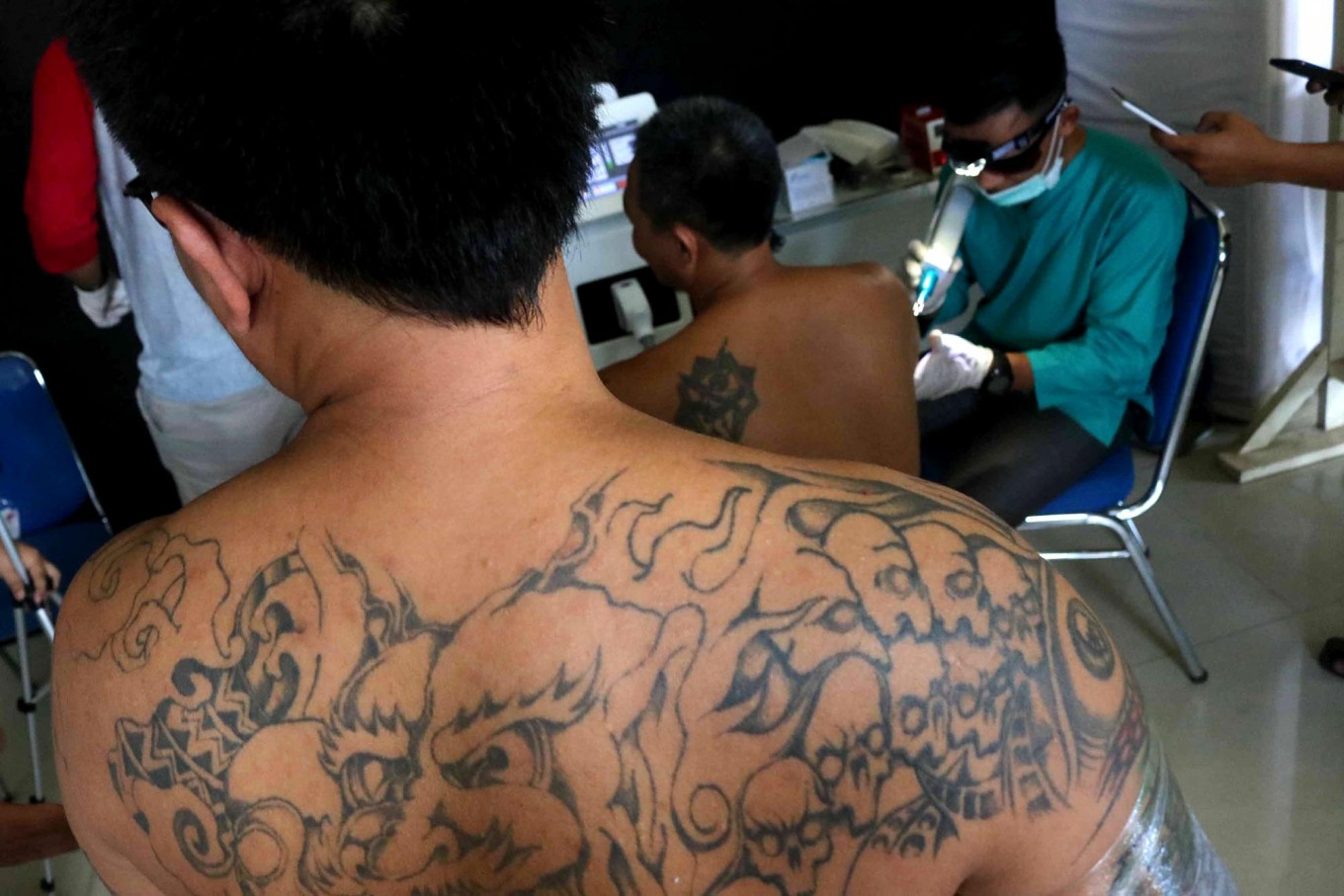 Next in line: People with tattoos wait for their turn to have their tattoos removed. JP/Maksum Nur Fauzan