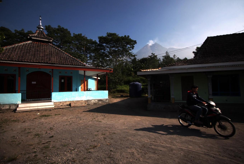 A motorcyclist leaves an empty mosque in Balerante village. JP/Boy T. Harjanto