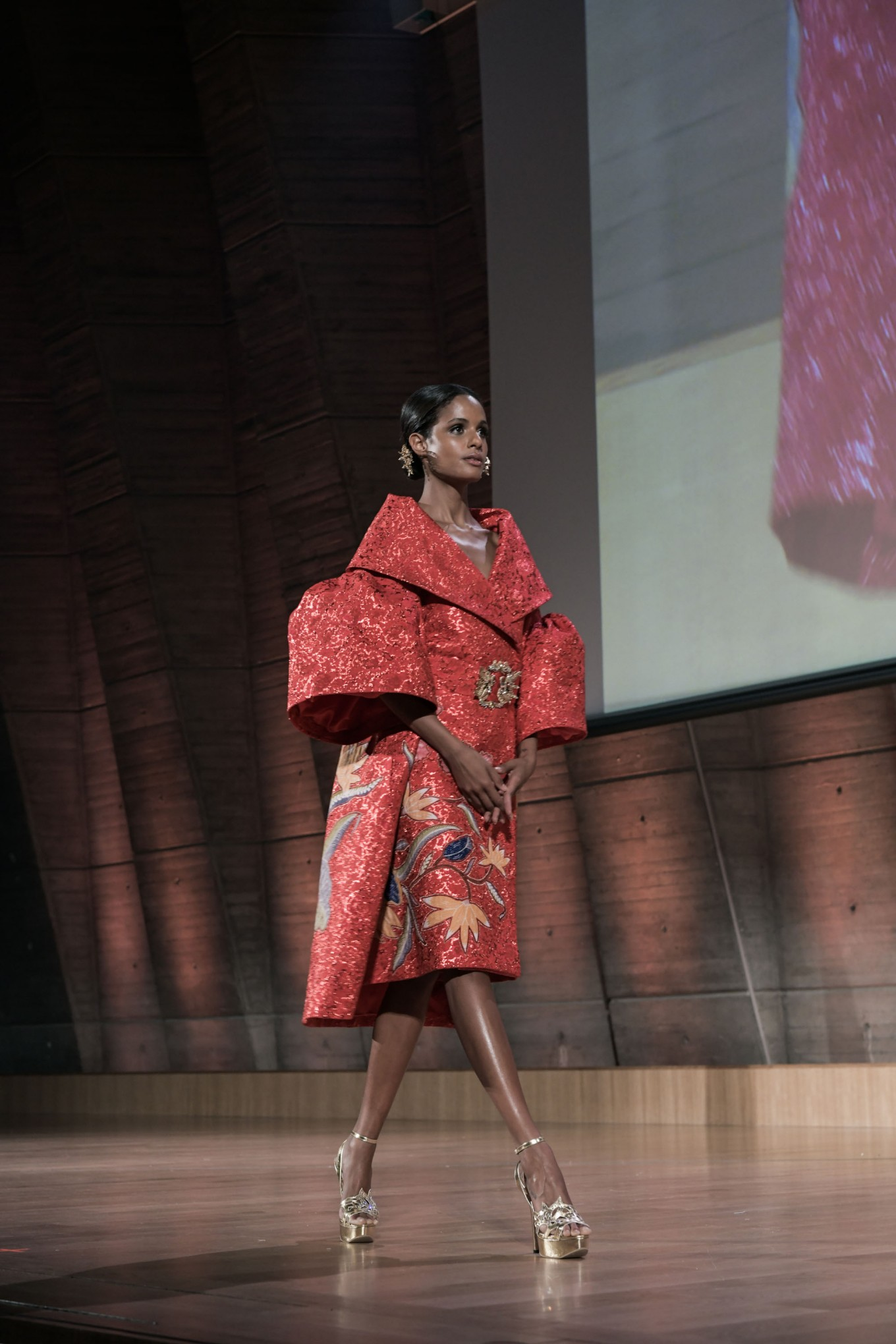 The fiery red dress, created by Denny Wirawan, highlights batik motif signature of Kudus regency in Central Java.