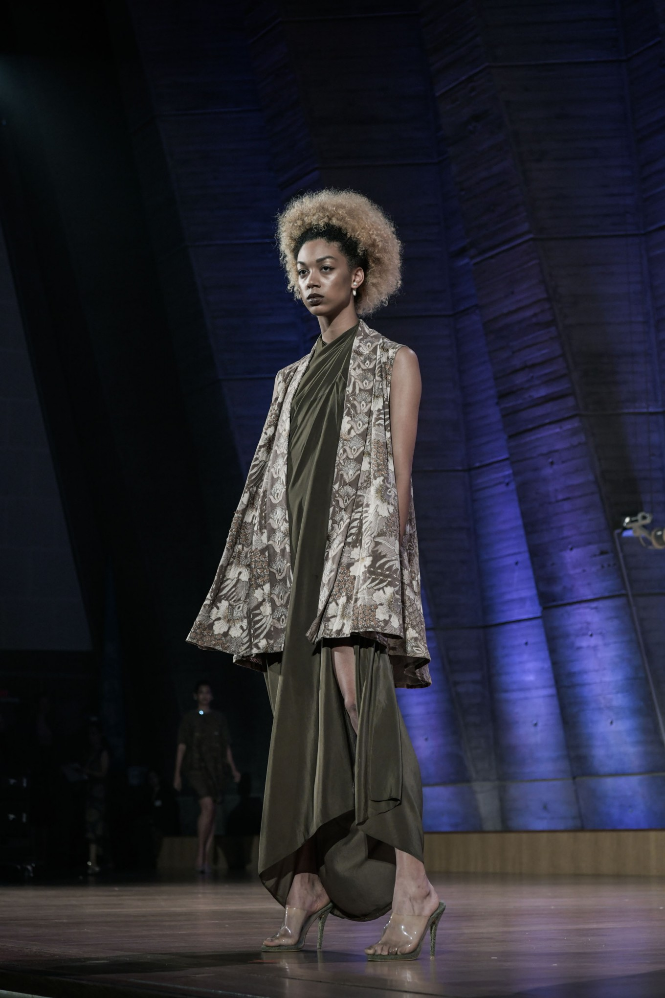 Oscar Lawalata took on a minimalist design dress that is instantly upgraded by a batik throw.