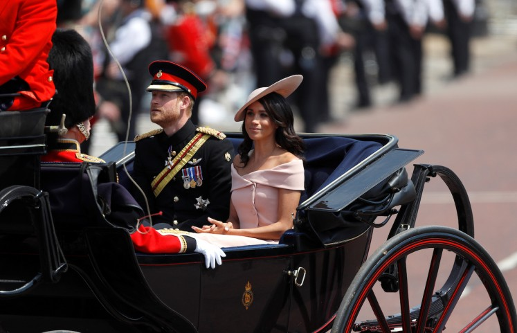 Britain's Prince Harry and Meghan, Duchess of Sussex, take part in the Trooping of the Colour parade in central London, Britain, June 9