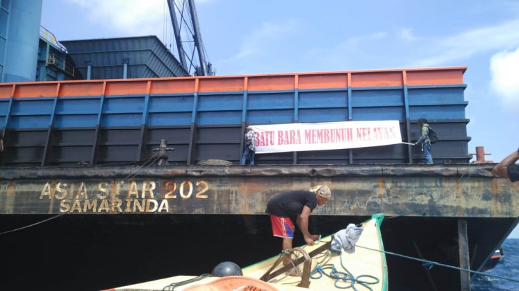 They put banners on some of the pontoons, expressing their objection to the coal loading activity.