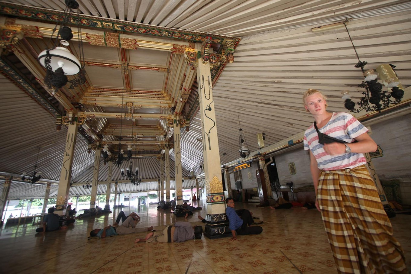 A Danish tourist wears a sarong upon entering the mosque, as required. JP/Boy T. Harjanto