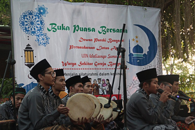 Togetherness: Members of Jami'atul Quro wal Huffadh, a rebana (traditional tambourine) musical group, sing Islamic songs during a breaking-of-the fast event held by the St.Theresia Bongsari Church in Semarang, Central Java, on June 1.
