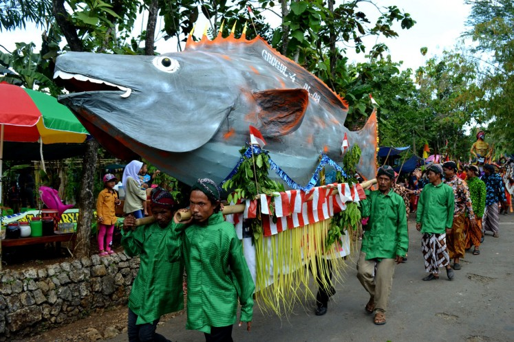 One of Jumiyo's papier m'ché sculptures are featured in a village ceremony  to celebrate the harvest.