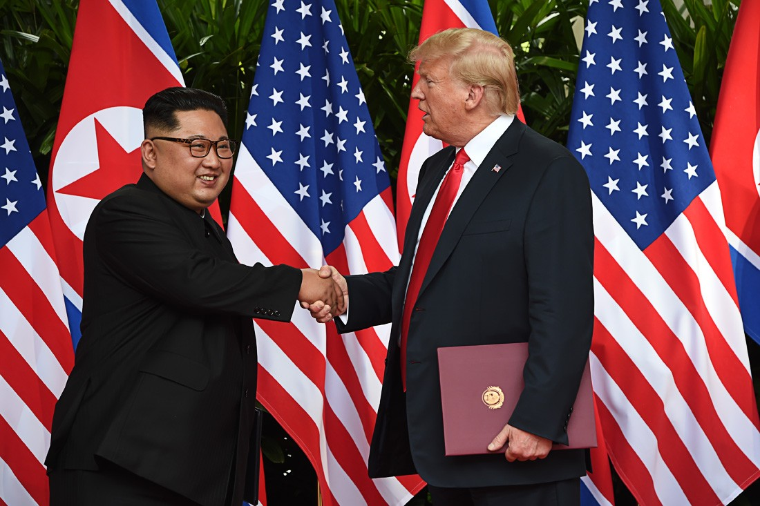 Trump, Kim sign 'comprehensive document'