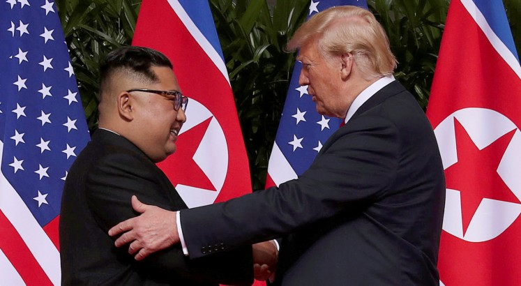 Kim-Trump summit commences with handshake