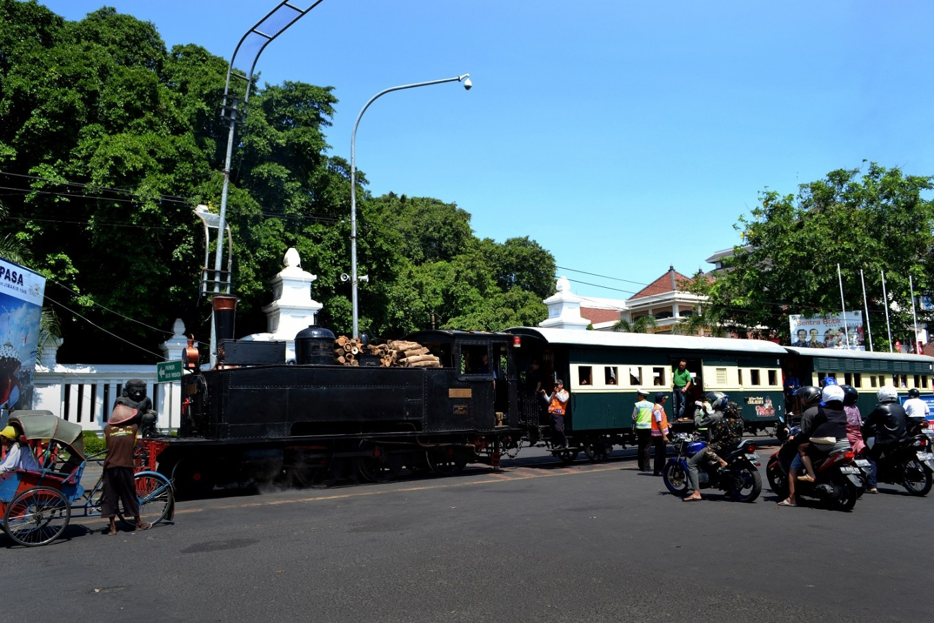 The Jaladara steam train passes Gladag, a batik center in Surakarta, Central Java.